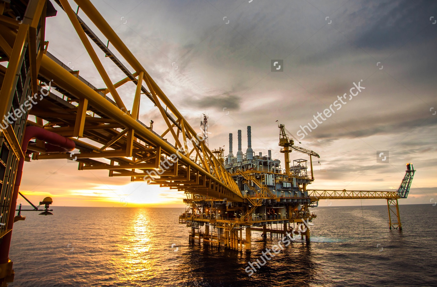 stock-photo-offshore-oil-and-rig-platform-in-sunset-or